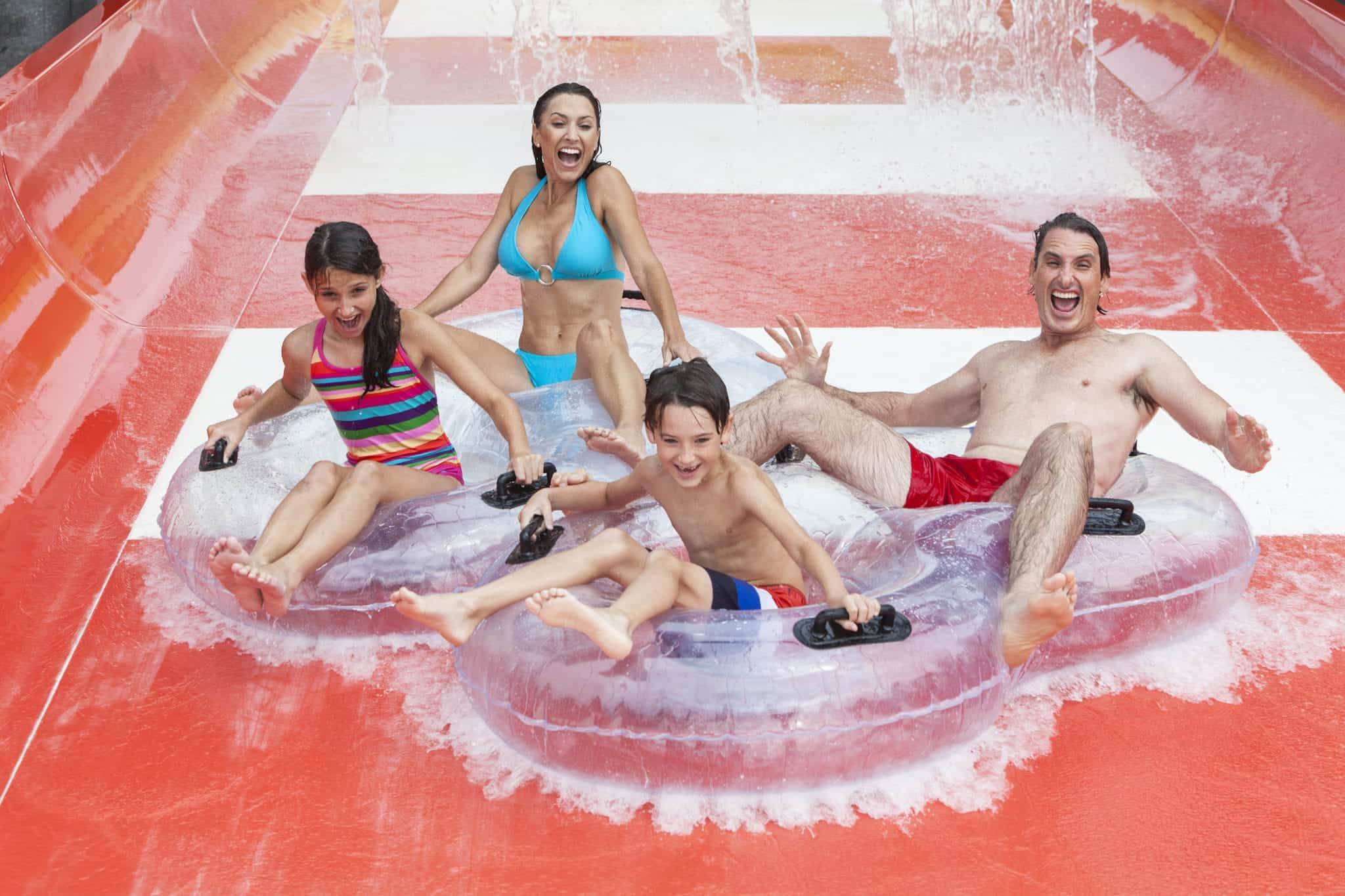 Family tubing down a water slide at Dolly's Splash Country