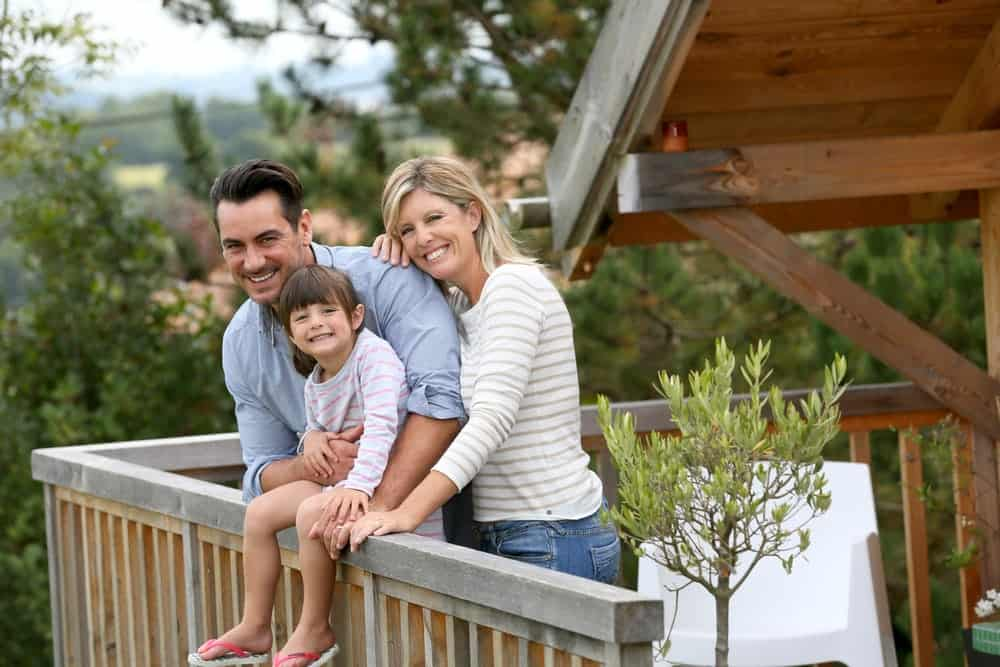 Happy family on the porch of a Gatlinburg cabin