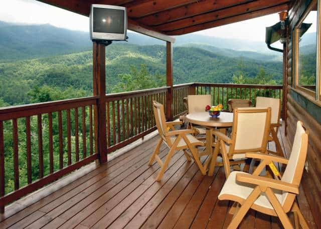 Chairs and tables on the deck of a Gatlinburg cabin.