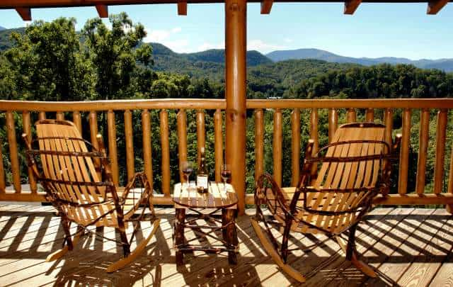 rocking chairs and table on the deck of a Gatlinburg TN vacation rental