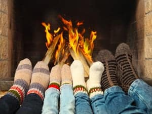 people with socks near the fire