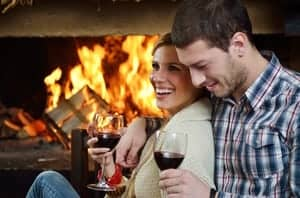 couple in front of a fire
