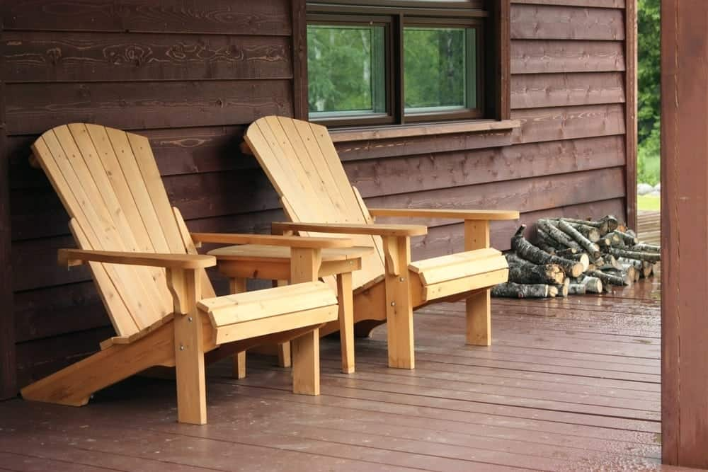 Chairs on the porch of a cabin