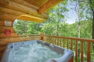hot tub on deck of 2 bedroom cabin in gatlinburg
