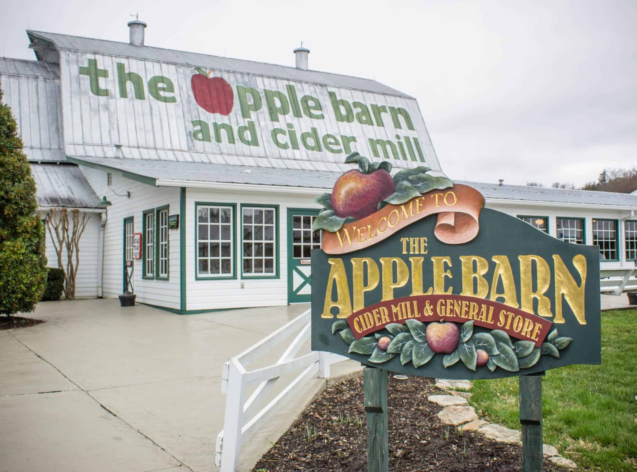 exterior of the apple barn and cider mill with a sign